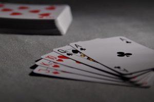 Card Games US playing cards poker bridge game laying on ground 300x200 - Card Games-US-playing-cards-poker-bridge-game-laying-on-ground