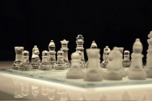 Top Games to Exercise Your Brain US Glass Chess on black Background 300x200 - Top Games to Exercise Your Brain-US-Glass Chess on black Background