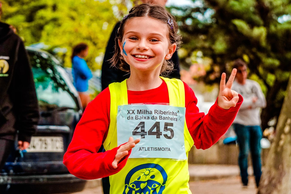 4 Reasons Why Sports Make Us Happier US a hilding happily running for a race - 4 Reasons Why Sports Make Us Happier