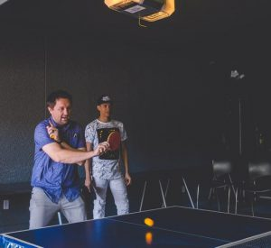 It give You More Energy US man in blue playing table tennis with another man as his audience 300x275 - It give You More Energy-US-man-in-blue-playing-table-tennis-with-another-man-as-his-audience